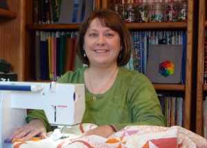 Lori Miller Designs Lori sewing